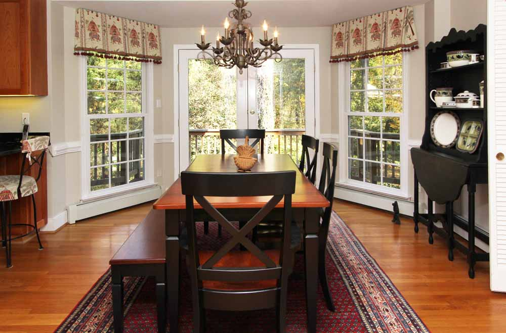 Formal Living Room Dining Adjoining The Kitchen With Bay And French Doors Onto Deck